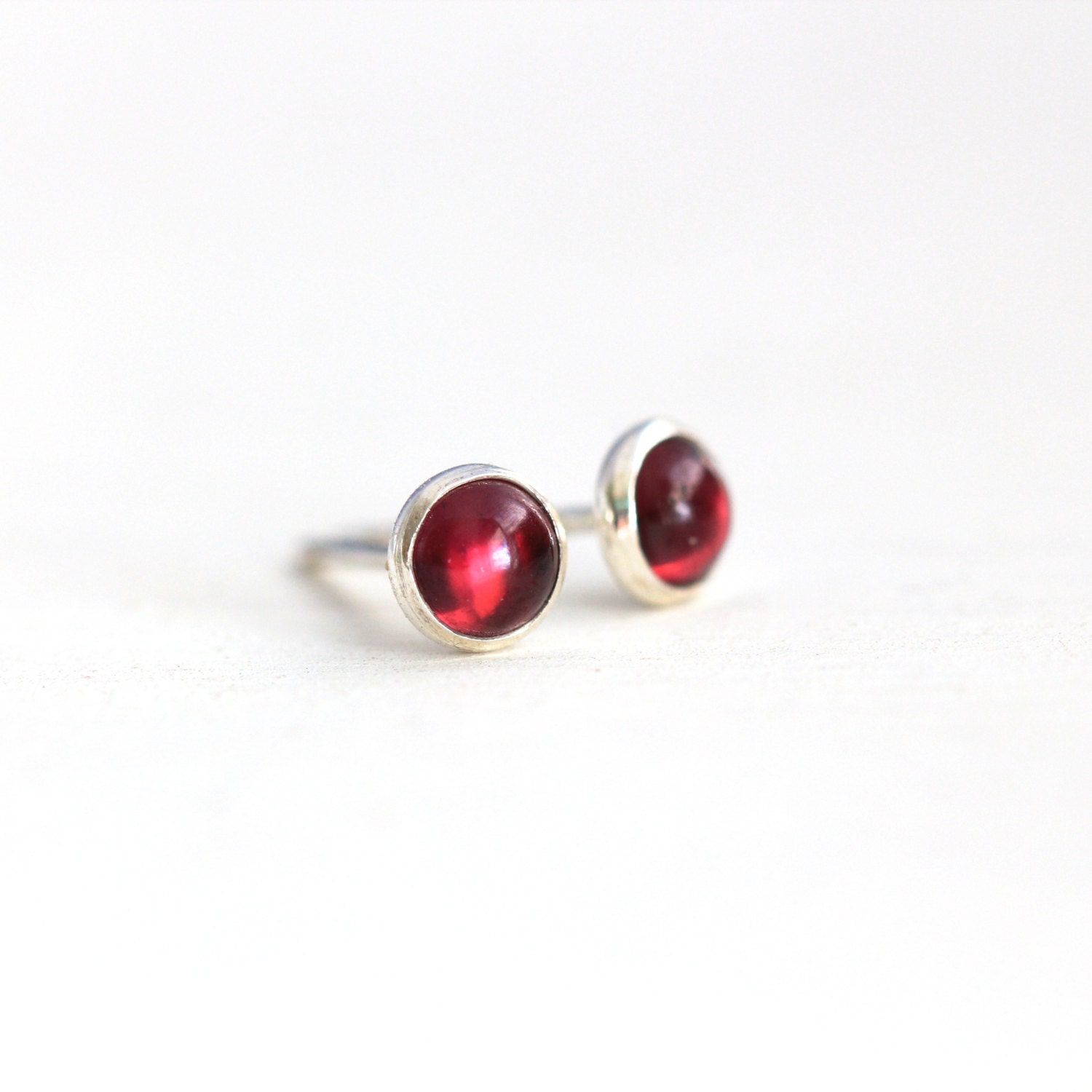 tiny garnet stud earrings sterling silver and garnet post