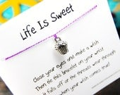 Life Is Sweet - Wish Bracelet With 3-D Cupcake Charm - Shown In The Color LIGHT PURPLE - Over 100 Different Colors Are Also Available