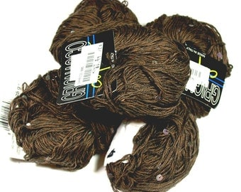 7 skeins of  Grignasco Caprice Yarn, 5 brown, 1 black and 1 white  with gittery sequins, made in Italy, 25g each