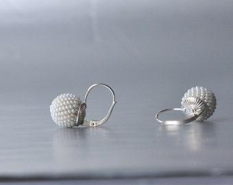 globe earrings pearly white