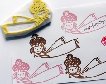 winter girl hand carved rubber stamp. knitted hat and scarf. christmas new year card making. diy party invites. handmade by talktothesun