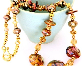 Gold Lampwork Bead Necklace. Gold Tribal Necklace. Scrolled Beads. Glass Bead Jewelry.