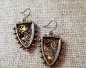 Antiqued Brass Clcokwork Clutter Studded Shield Earrings