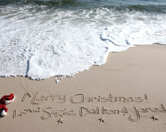 Personalized Christmas Greeting Beach Writing with a Santa Hat