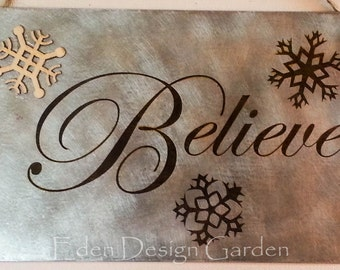 "Believe 5""x8"" etched metal sign in silver and rust with wooden snowflake"