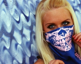 Pink Skull face On Blue Bandana Mask that Glows in the Dark a unique phosphorescent peach color Rave Party