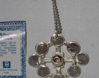 A silver-plated bronze pendant by PENTTI SARPANEVA Finland