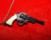 Large vintage 60's 70's off white and black plastic country western rockabilly punk gun revolver pendant silver tone chain