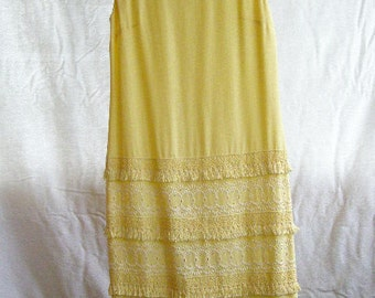 vintage shift dress, sleeveless pastel yellow with exquisite detail on skirt of embroidery, lace and tassels
