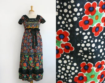 1970s Vintage Geoffrey Beene dress with a psychedelic floral, size small
