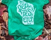 New Represent Wisconsin Green Baby Onesie. Grass Green Baby Jumper Celebrates the Midwest. Made in the USA.