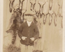 Fur Trapper's Son- 1920s Antique Photograph- Boy Posing with Raccoon and Skunk Pelts- Sepia Snapshot- Found Photo- Paper Ephemera