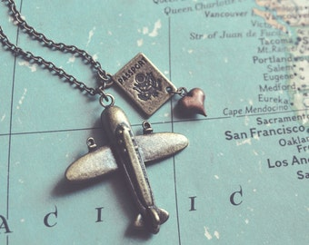 wanderlust. a whimsical airplane and passport necklace for travel lovers