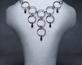 Rings Drop neck piece steel/purple