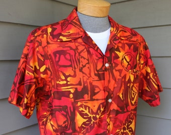 vintage 1970's -Rai Lani- Men's short sleeve Hawaiian shirt. Tribal batik style print in Red - Orange - Gold. Cotton poplin. Large