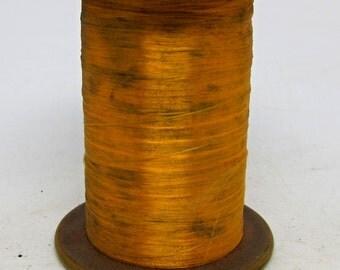 Large burnt yellow acetate fiber spool