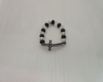 Beautiful Black Crystal sideway cross bracelet with black and clear glass beads.