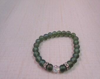 Green sea glass beaded bracelet.