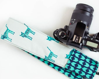 DSLR camera strap cover with lens cap pocket.  teal and navy kitties and arrows.
