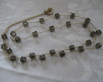 Vintage necklace with amber lucite beads.  Signed RB.