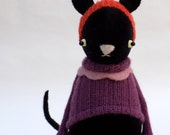 Black Velour Cat  -  Handmade plush sculpture wearing purple woollen pullover and felt pants.