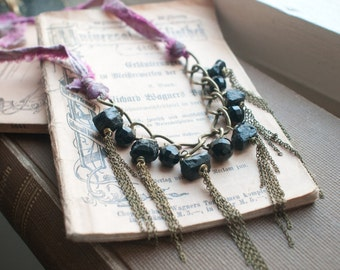 Antique french Jet cut glass buttons with rough black tourmaline and rubies, chain tassels and recycled silk tie necklace, wrap bracelet.