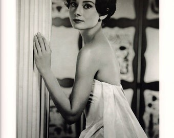 Portrait of Audrey Hepburn Looking Over Her Shoulder in a Doorway Poster Print