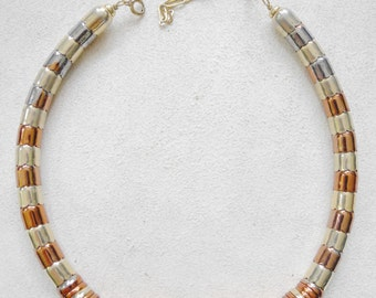 80's rocker/Egyptian style chunky gold and copper coloured metal choker/necklace.
