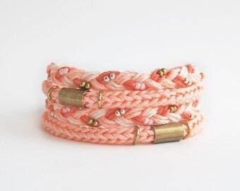 Peach wrap bracelet, cord bracelet, knit bracelet, braided bracelet with brass tubes, pastel orange