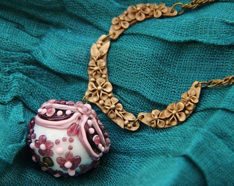 Pink and violet lampwork glass pendant #1 with small flowers and bronze decor. Baroque style.