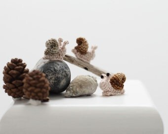 Miniature crochet snail toy. Amigurumi snail. Crochet miniature art.
