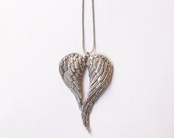 Winged heart charm pendant