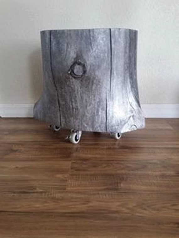 Pewter tree stump with casters