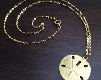 sand dollar necklace, gold sand dollar, sand dollar, gold sand dollar necklace, sand dollar pendant, sand dollar jewelry, gold necklace