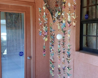 Origami Crane and Antique Fishing Net with Sea Shells