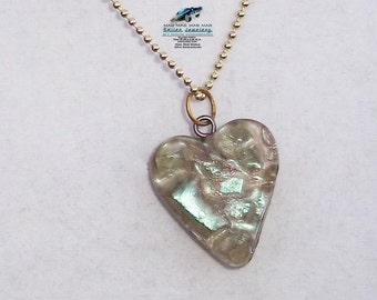 Heart shaped It's a Mad4 World necklace with authentic movie car glass
