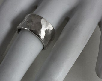 Sterling silver, cast ring in size 7.5