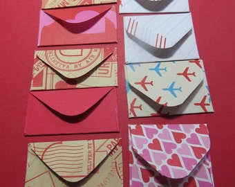 "8 Tiny envelopes with 8 tags and 8 fancy ""stamps"", Valentine's Day, red, pink, cream, kraft, hold sentiments, 24 pieces, 1-3/4"" x 1-3/8""."