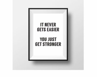 It never gets easier you just get stronger typography print black and white motivational wall art  (from US Letter up to A0 size)