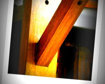 ENUVE. Wall light in solidwood