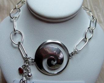 Swirl evolution symbol bracelet