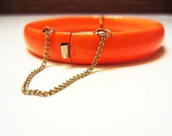 Mid-century, bright orange metal bracelet