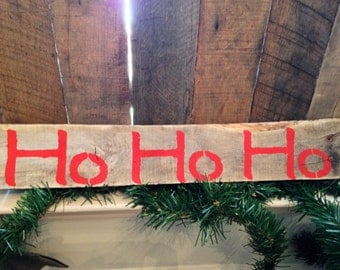 HO HO HO Holiday sign in red on reclaimed wood