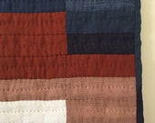 Hand sewn quilted linen wall hanging