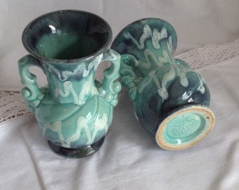 antique french majolica vases in a beautiful iridescent green