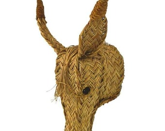Donke head of esparto grass. 35 centimeters. For hang on the wall. Child decoration.