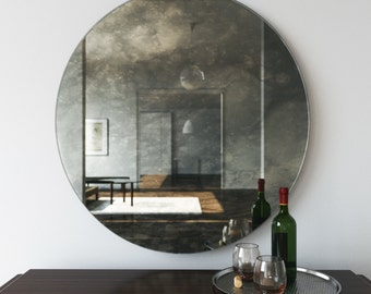 Antiqued round mirror. Decorative wall mirror that casts an interesting, cloudy reflection of room. Round mirror with European chic design.