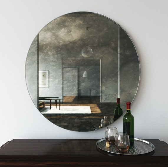 Antiqued Round Mirror Decorative Wall Mirror That Casts An