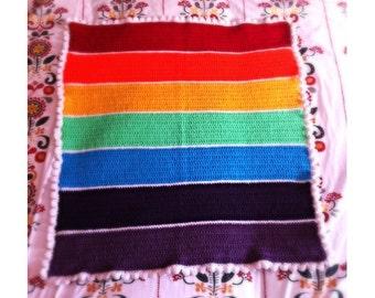 Rainbow baby blanket, crocheted in soft wool. Great for cot, crib, car seat, pushchair, pram or stroller.
