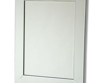 Frameless all glass mirror.